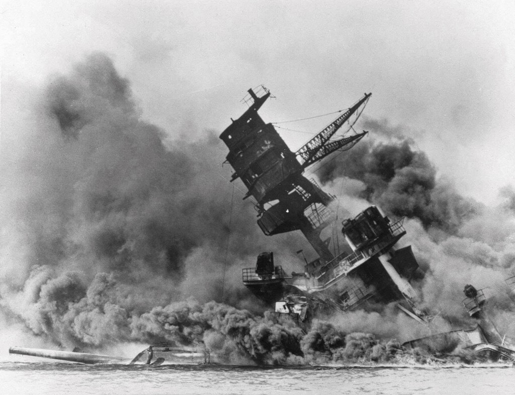 In this Dec. 7, 1941 file photo, smoke rises from the battleship USS Arizona as it sinks during the Japanese attack on Pearl Harbor, Hawaii. About 20