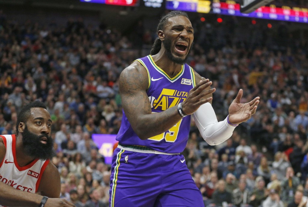 Utah Jazz forward Jae Crowder (99) reacts after being called with for foul, as Houston Rockets guard James Harden, left, watches during the first half
