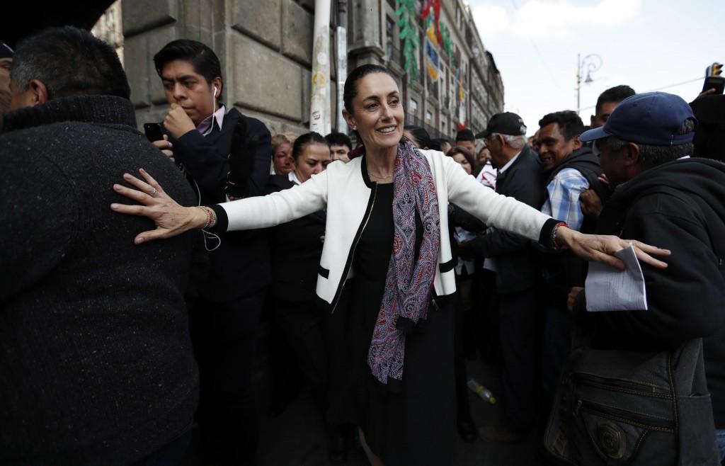 Claudia Sheinbaum, Mexico City's newly sworn in mayor, takes a walk to the Zocalo in Mexico City, on Wednesday, Dec. 5, 2018. Sheinbaum is Mexico City