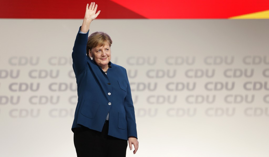 German Chancellor and chairwoman of the German Christian Democratic Union (CDU), Angela Merkel, waves after her farewell speech during a party convent