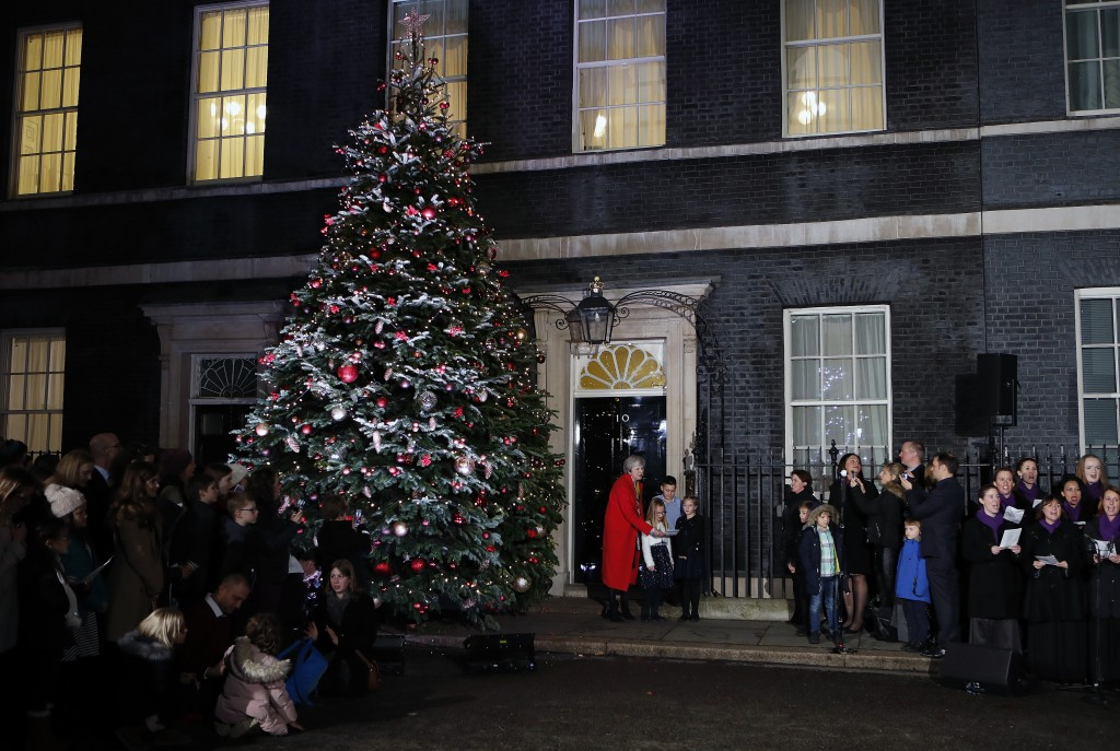 Britain's Prime Minister Theresa May attends the ceremony to light up a Christmas tree at 10 Downing Street in London, Thursday, Dec. 6, 2018. (AP Pho