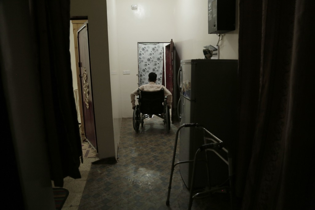 Anas al-Sarrari pushes his wheelchair in his home in Marib, Yemen in this July 29, 2018 photo. The activist recalled how after 60 days of being hung b