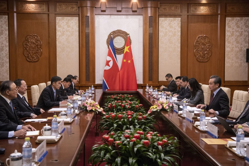 North Korean Foreign Minister Ri Yong Ho, second left, meets China's Foreign Minister Wang Yi, right, during a meeting at the Diaoyutai State Guesthou