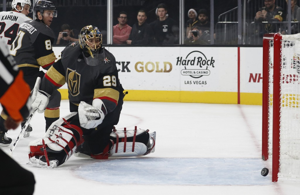 Vegas Golden Knights goaltender Marc-Andre Fleury (29) watches a puck nearly go into the goal during the first period of an NHL hockey game against th