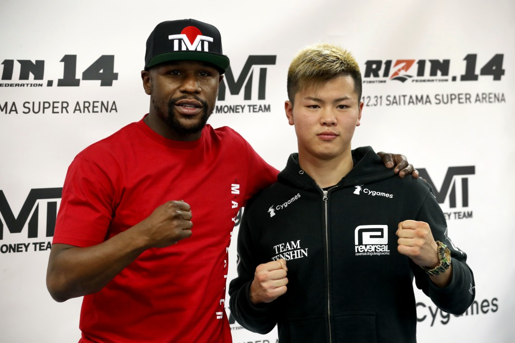 Floyd Mayweather Jr., left, poses with kickboxer Tenshin Nasukawa, of Japan, during a news conference at the Mayweather Boxing Club in Las Vegas, Thur