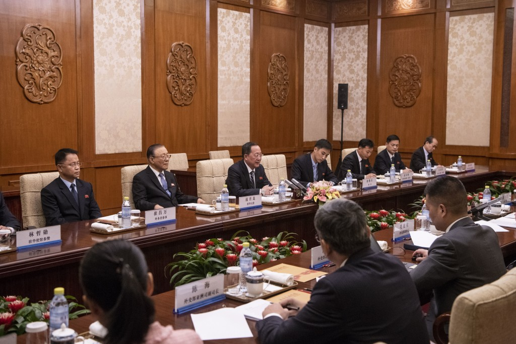 North Korean Foreign Minister Ri Yong Ho, center, speaks to China's Foreign Minister Wang Yi during a meeting at the Diaoyutai State Guesthouse in Bei