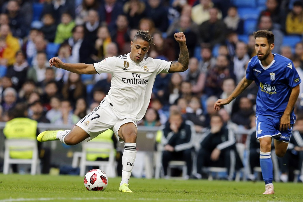 Real Madrid's Mariano Diaz, left, lines up a shot on goal during a round of 32, 2nd leg, Spanish Copa del Rey soccer match between Real Madrid and Mel
