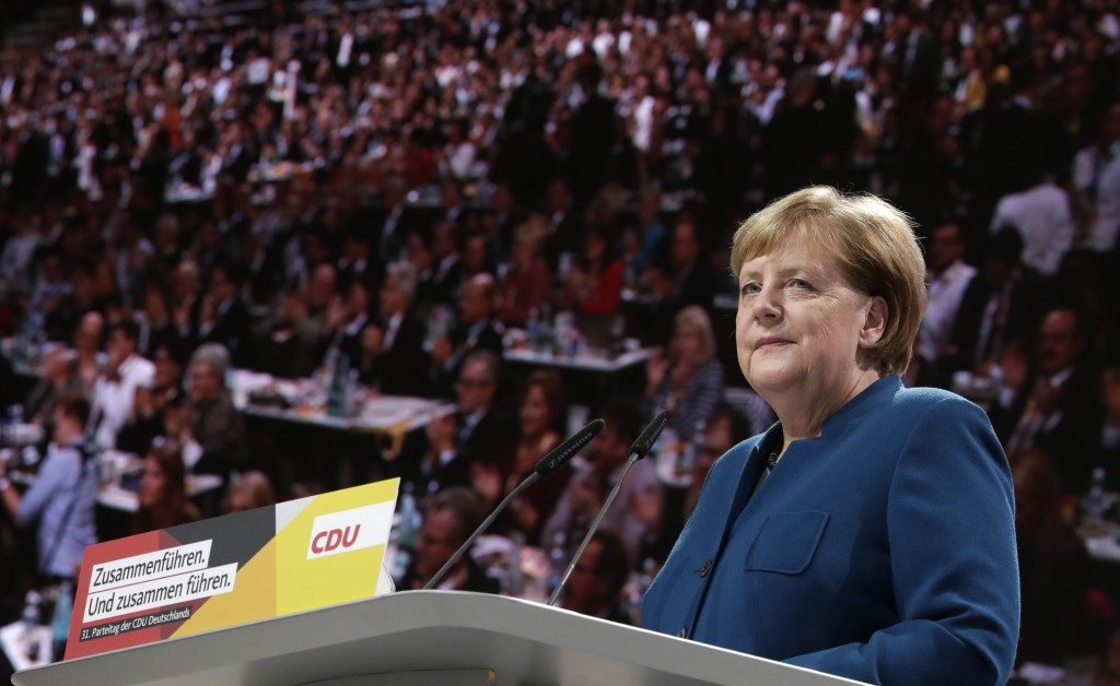 German Chancellor Angela Merkel listens to applause during her speech at the party convention of the Christian Democratic Party CDU in Hamburg, German