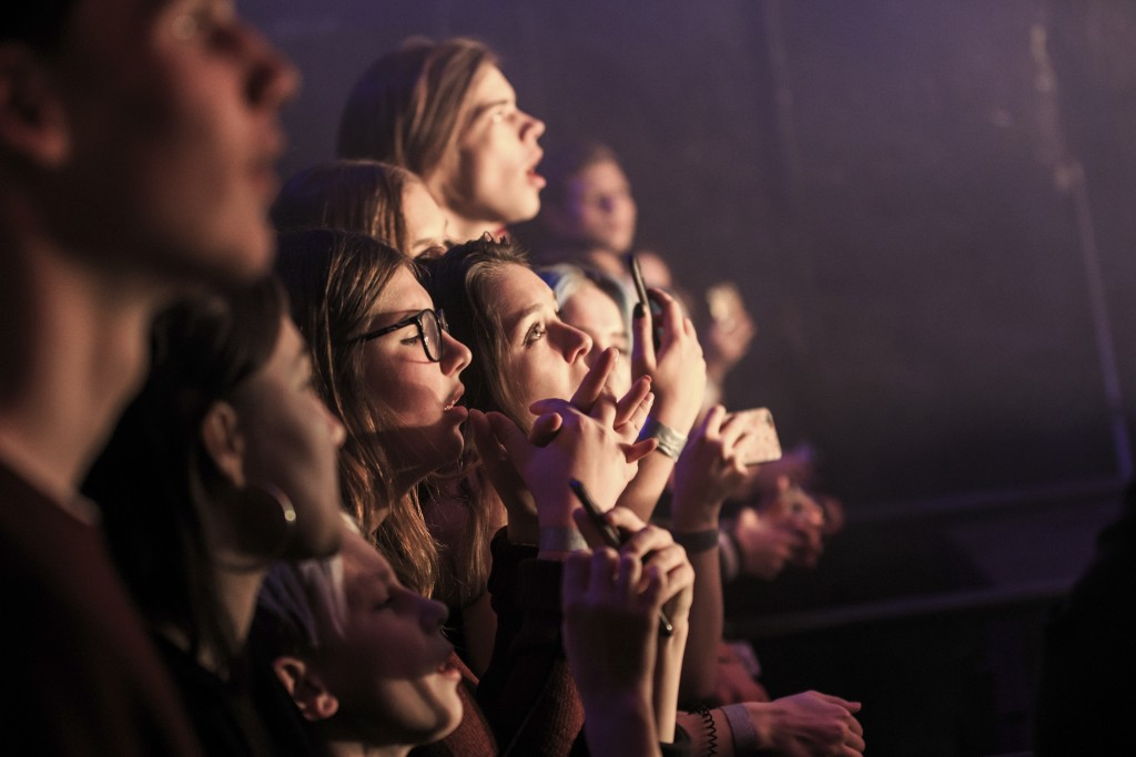 In this photo taken on Thursday, Nov. 29, 2018, fans watch as Russian musician Nastya Kreslina, member of electronic duo called IC3PEAK performs durin