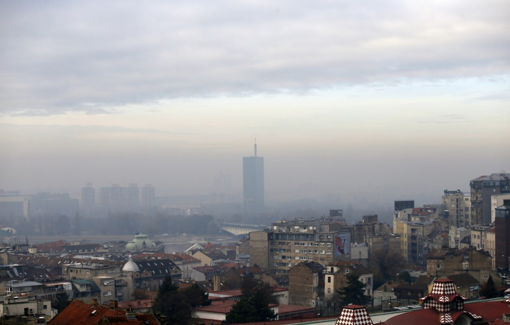 Fog and clouds blanket seen over Belgrade, Serbia, Friday, Dec. 7, 2018. The two-week U.N. climate meeting COP24 in Poland is intended to finalize det