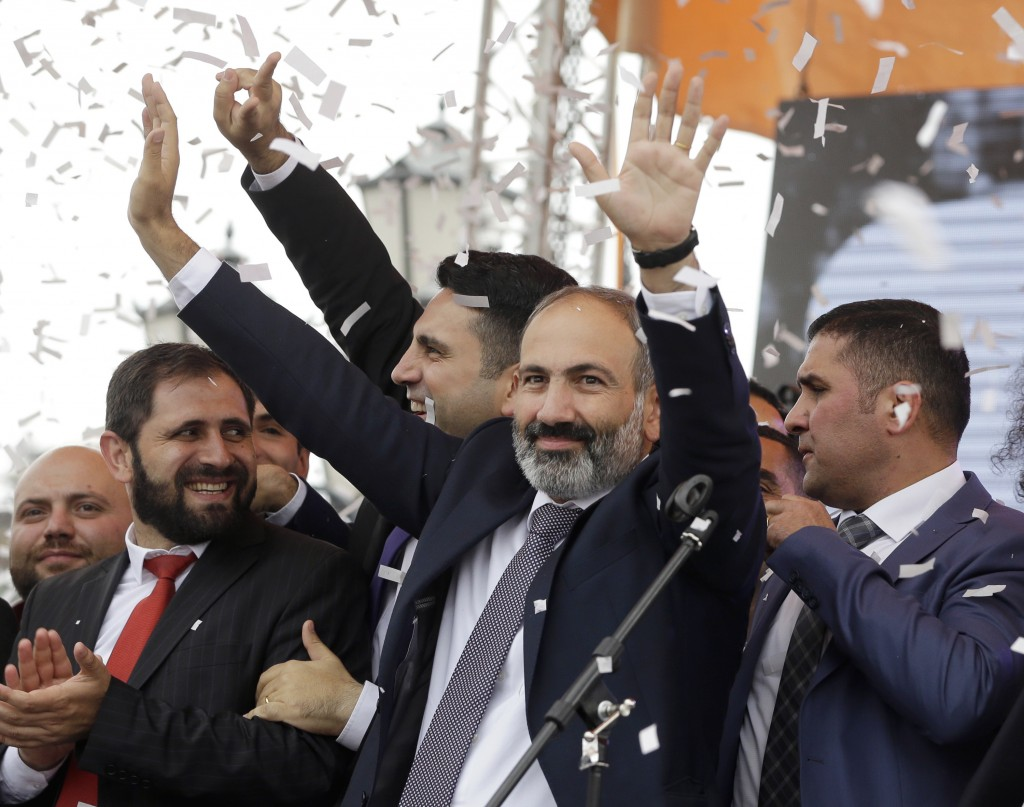 FILE - In this file photo taken on Tuesday, May 8, 2018, Armenian Prime Minister Nikol Pashinian gestures as he addresses the crowd in Republic Square