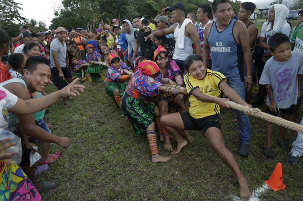 Guna women compete in the tug-of-war event during the second edition of their indigenous games, in Piriati, Panama, on Sunday, Nov. 25, 2018. Indigeno