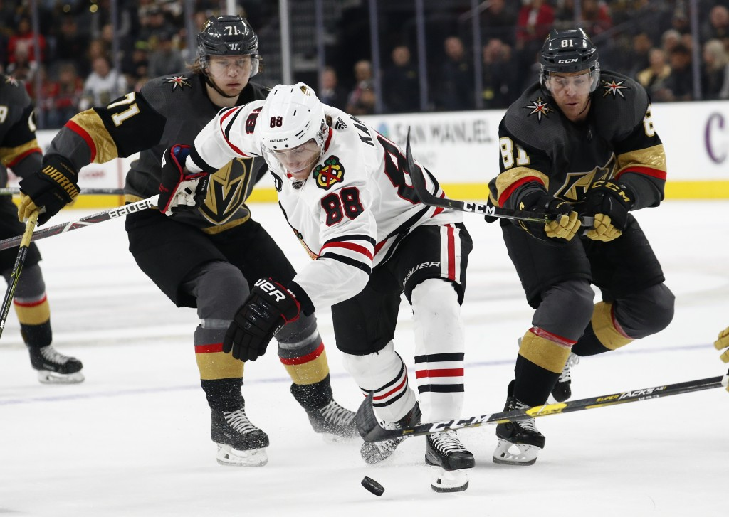Chicago Blackhawks right wing Patrick Kane (88) vies for the puck with Vegas Golden Knights' William Karlsson (71) and Jonathan Marchessault (81) duri