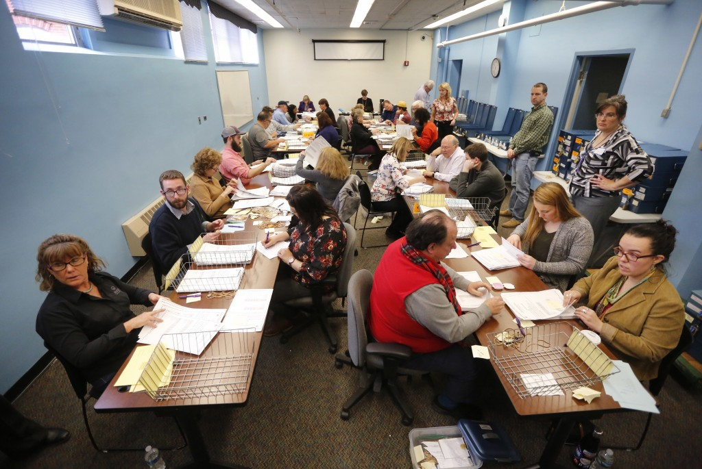 Ballots are recounted in Maine's 2nd Congressional District, Thursday, Dec. 6, 2018, in Augusta, Maine. The recount was requested by outgoing U.S. Rep