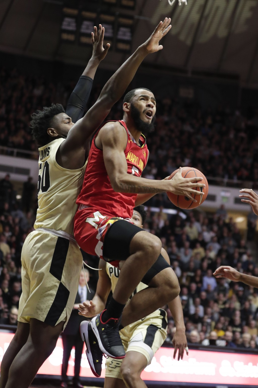 Maryland guard Eric Ayala (5) shoots in front of Purdue forward Trevion Williams (50) during the first half of an NCAA college basketball game in West