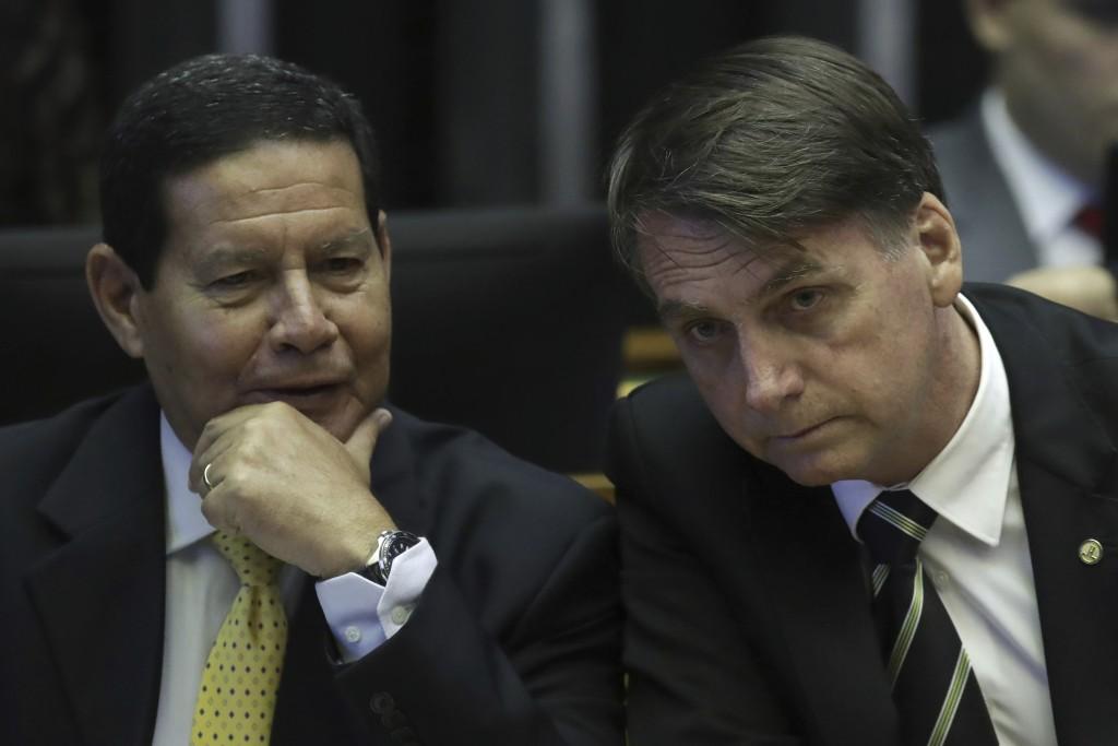 FILE - In this Nov. 6, 2018 file photo, Brazilian President-elect Jair Bolsonaro, right, and his Vice President Gen. Hamilton Mourao attend a ceremony