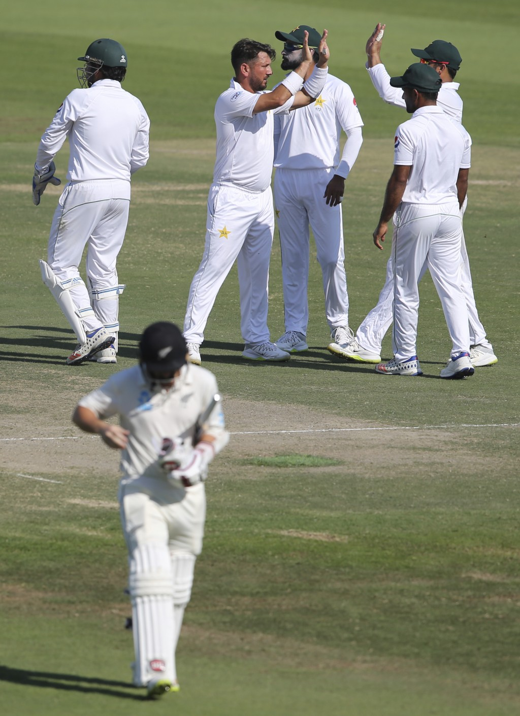 Pakistan's Yasir Shah celebrates dismissal of New Zealand's BJ Watling with team mates in their test match in Abu Dhabi, United Arab Emirates, Friday,