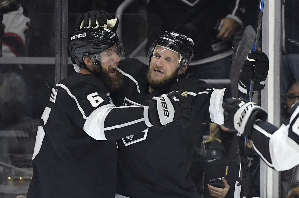 Los Angeles Kings left wing Kyle Clifford, right, celebrates his goal with defenseman Jake Muzzin during the second period of an NHL hockey game again