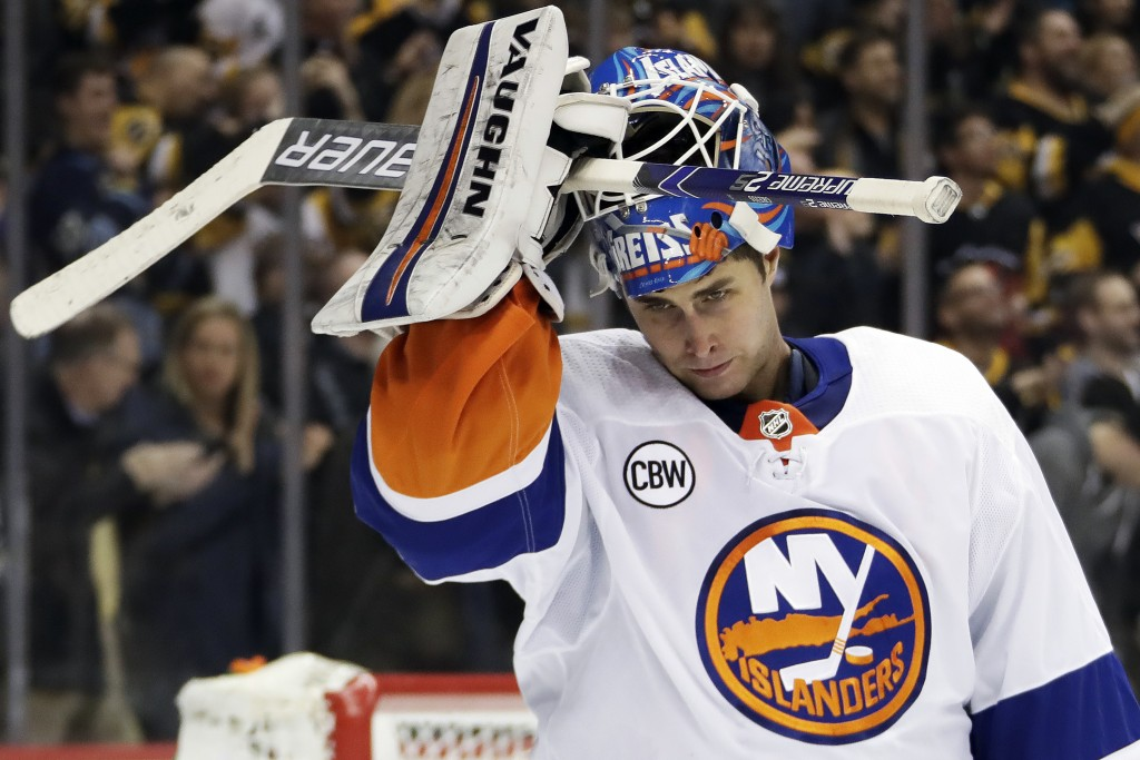 New York Islanders goaltender Thomas Greiss reacts after allowing a goal by Pittsburgh Penguins' Phil Kessel during the second period of an NHL hockey