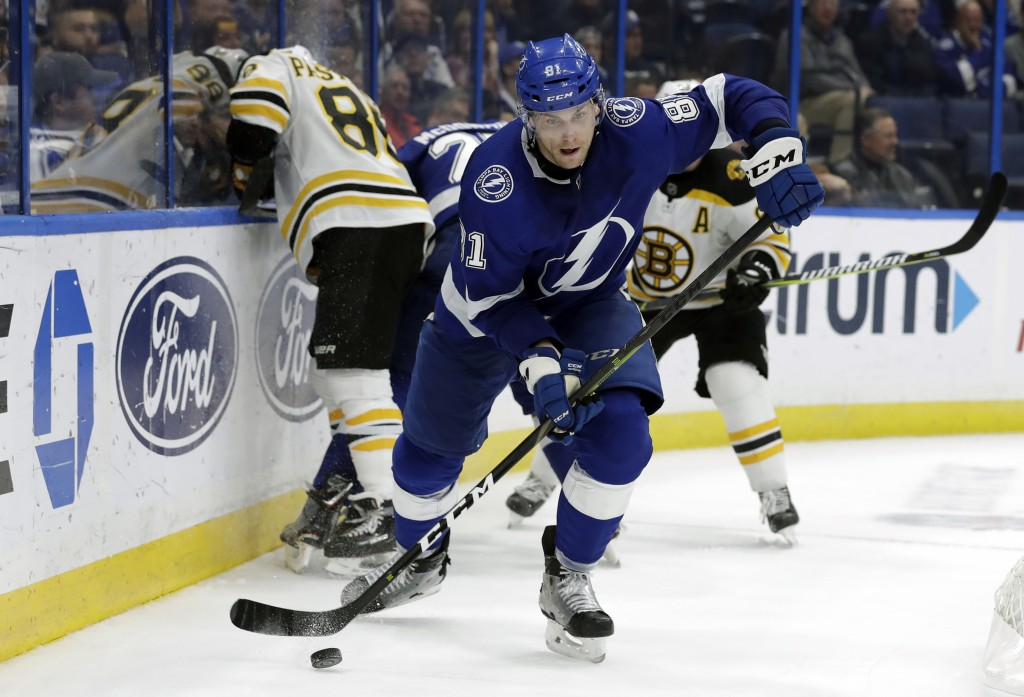 Tampa Bay Lightning defenseman Erik Cernak (81) goes away with the puck after a scrum behind the goal during the third period of the team's NHL hockey
