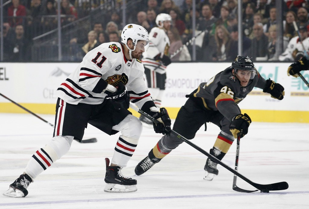 Chicago Blackhawks left wing Brendan Perlini (11) vies for the puck with Vegas Golden Knights left wing Tomas Nosek (92) during the first period of an