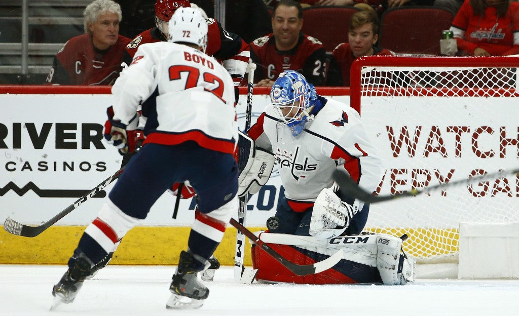 Washington Capitals goaltender Pheonix Copley (1) makes a save on a shot against the Arizona Coyotes as Capitals center Travis Boyd (72) watches durin