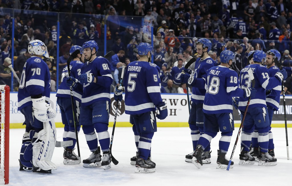 The Tampa Bay Lightning celebrate a 3-2 win over the Boston Bruins in an NHL hockey game Thursday, Dec. 6, 2018, in Tampa, Fla. (AP Photo/Chris O'Mear