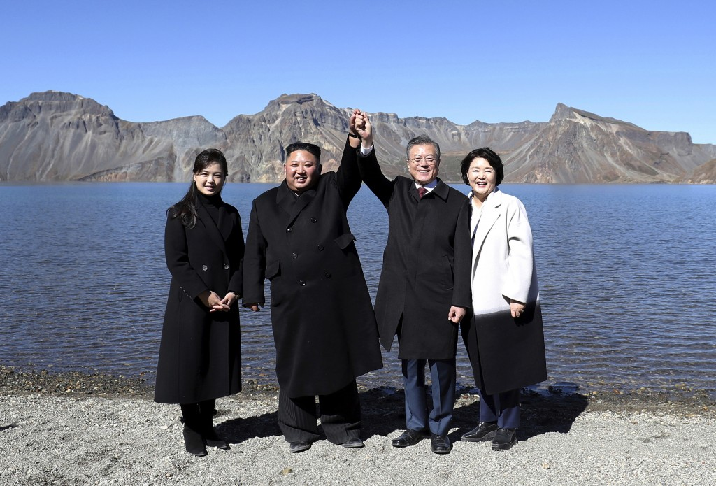 FILE - In this Sept. 20, 2018 file photo, South Korean President Moon Jae-in, second from right, and his wife Kim Jung-sook, right, stand with North K