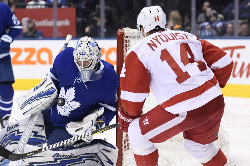 Toronto Maple Leafs goaltender Garret Sparks (40) makes a save on Detroit Red Wings right wing Gustav Nyquist (14) during the third period of an NHL h