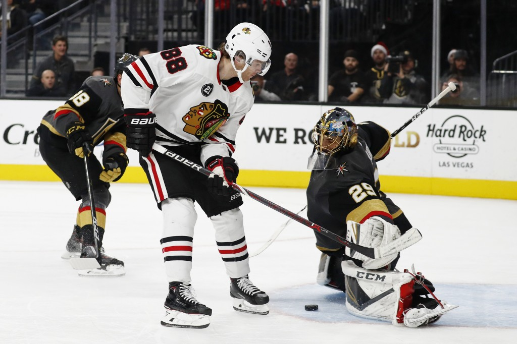Vegas Golden Knights goaltender Marc-Andre Fleury (29) blocks a shot by Chicago Blackhawks right wing Patrick Kane (88) during the third period of an