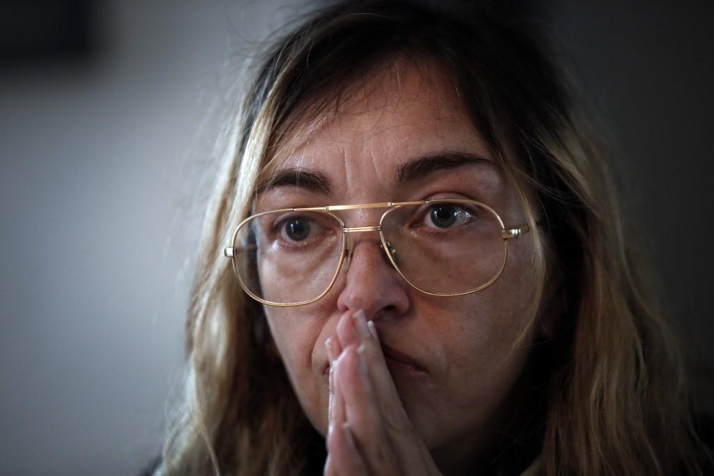 Mathilde Pouzet speaks during an interview with Associated Press in Villeneuve-La-Garenne, outside Paris, Thursday, Dec. 6, 2018. Pouzet set out for P
