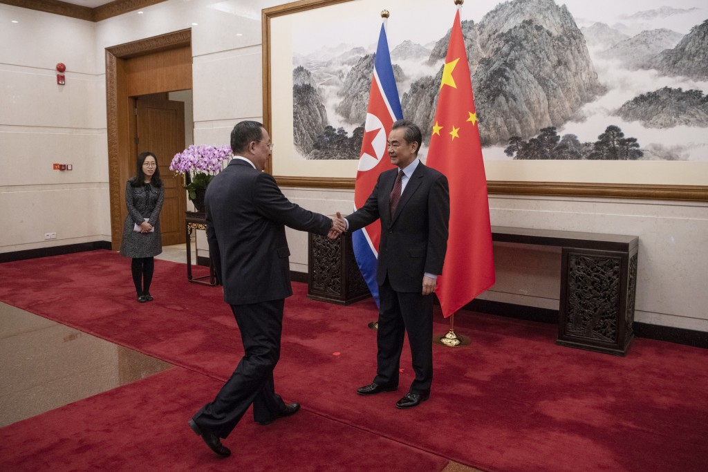 North Korean Foreign Minister Ri Yong Ho, center, meets China's Foreign Minister Wang Yi at the Diaoyutai State Guesthouse in Beijing  Friday, Dec. 7,