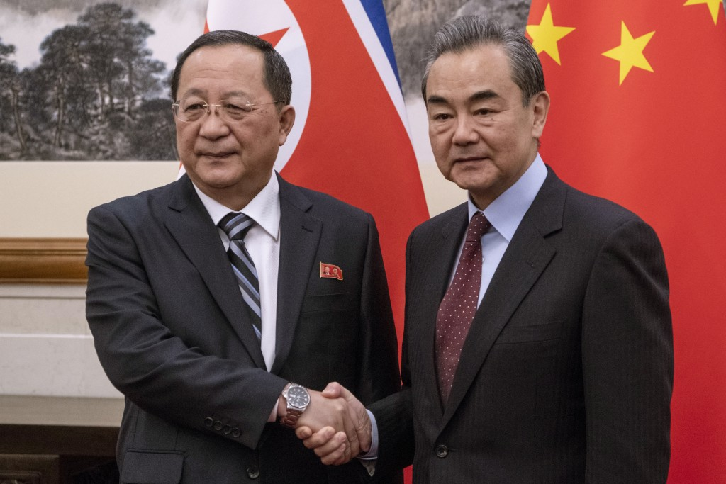 North Korean Foreign Minister Ri Yong Ho, left meets China's Foreign Minister Wang Yi at the Diaoyutai State Guesthouse in Beijing  Friday, Dec. 7, 20