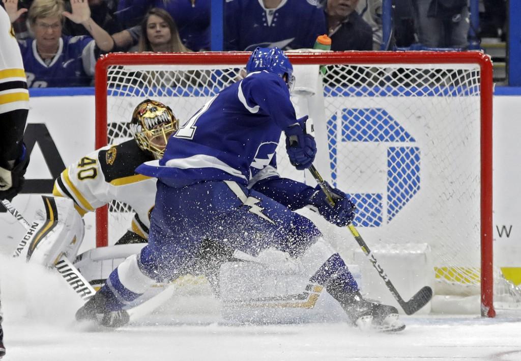 Tampa Bay Lightning center Anthony Cirelli (71) beats Boston Bruins goaltender Tuukka Rask (40) for a goal during the third period of an NHL hockey ga