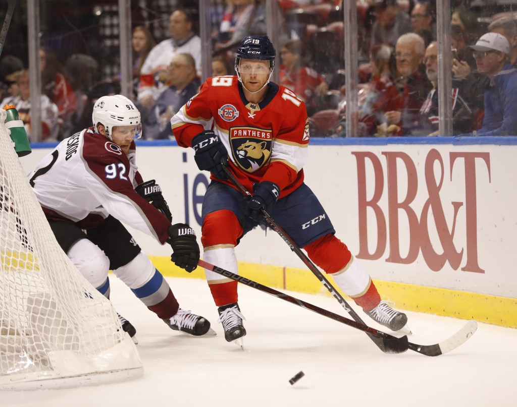 Colorado Avalanche left wing Gabriel Landeskog (92) and Florida Panthers defenseman Mike Matheson (19) battle for the puck during the first period of