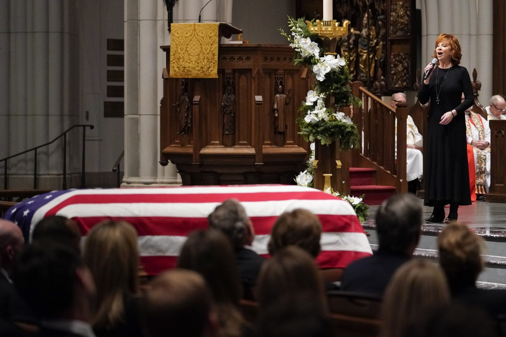 "Reba McEntire sings ""The Lord's Prayer"" during a funeral service for former President George H.W. Bush at St. Martin's Episcopal Church Thursday, Dec."