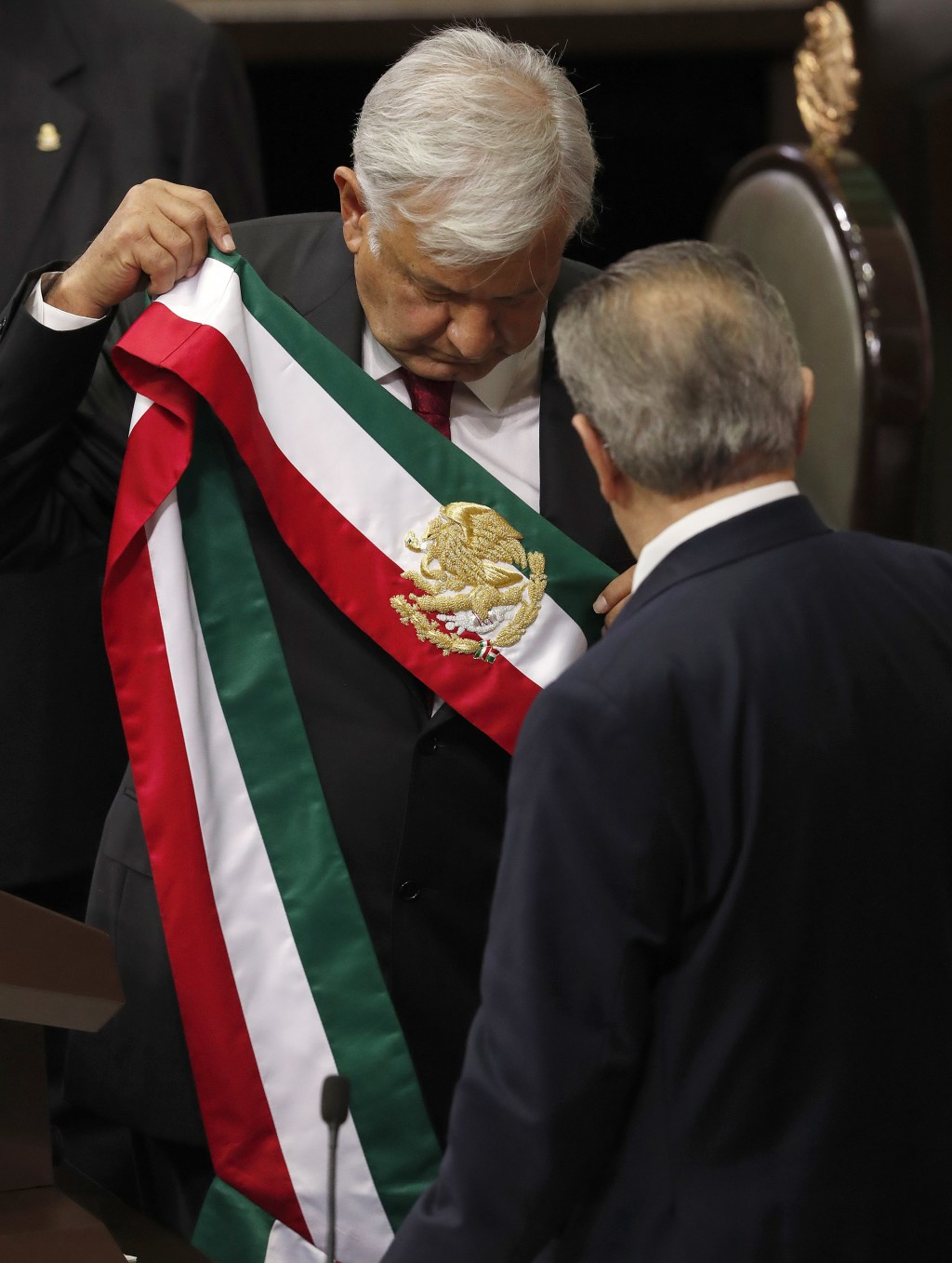 Mexico's new President Andres Manuel Lopez Obrador holds the presidential sash after taking the oath of office at the National Congress in Mexico City