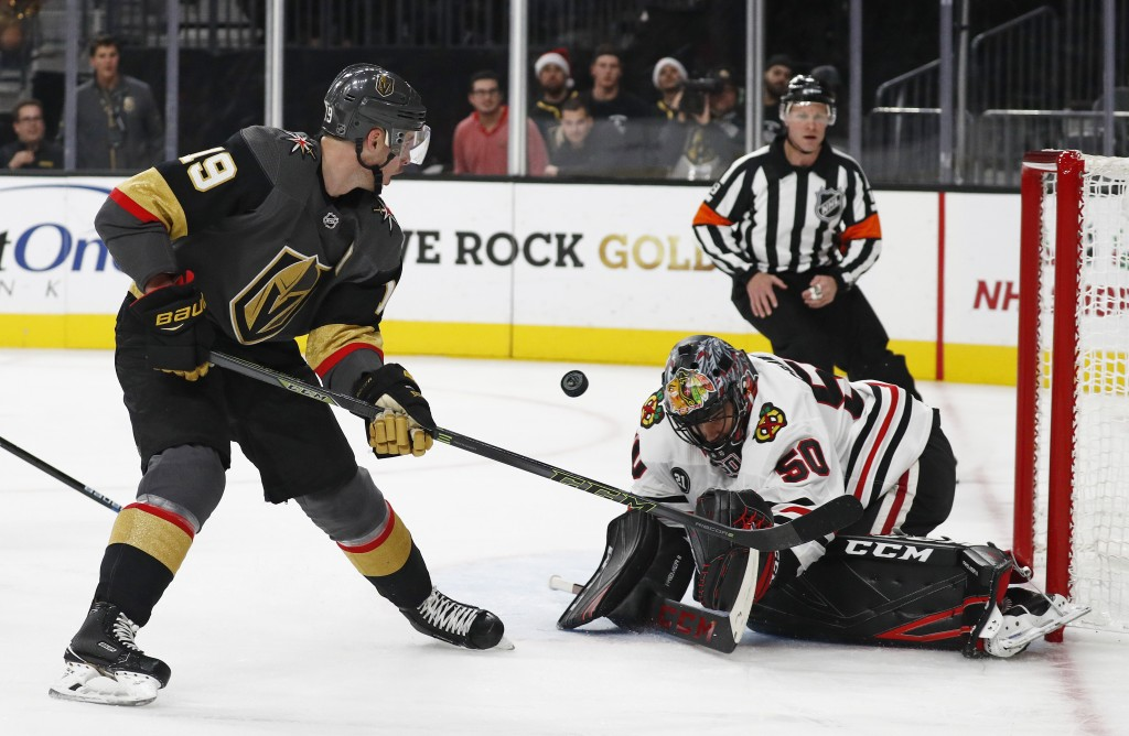 Chicago Blackhawks goaltender Corey Crawford (50) blocks a shot by Vegas Golden Knights right wing Reilly Smith (19) during the second period of an NH