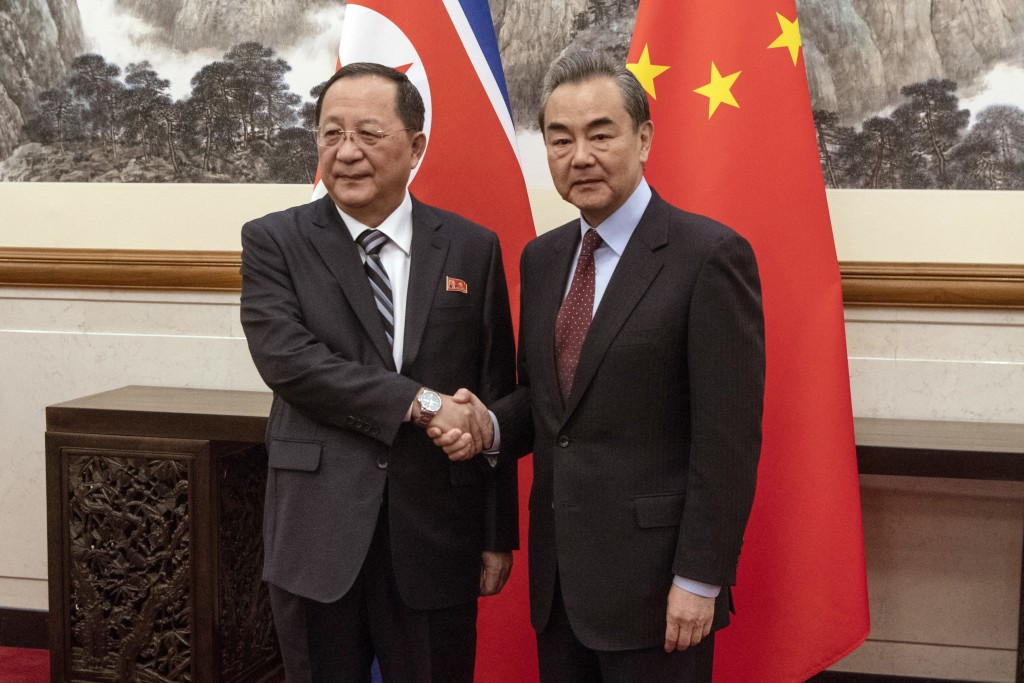North Korean Foreign Minister Ri Yong Ho, left, meets China's Foreign Minister Wang Yi at the Diaoyutai State Guesthouse in Beijing Friday, Dec. 7, 20