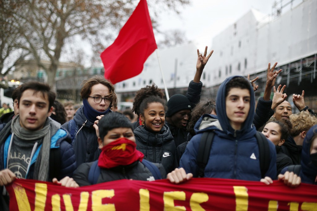School children demonstrate in Paris, Friday Dec.7, 2018. Footage showing the brutal arrest of high school students protesting outside Paris is causin
