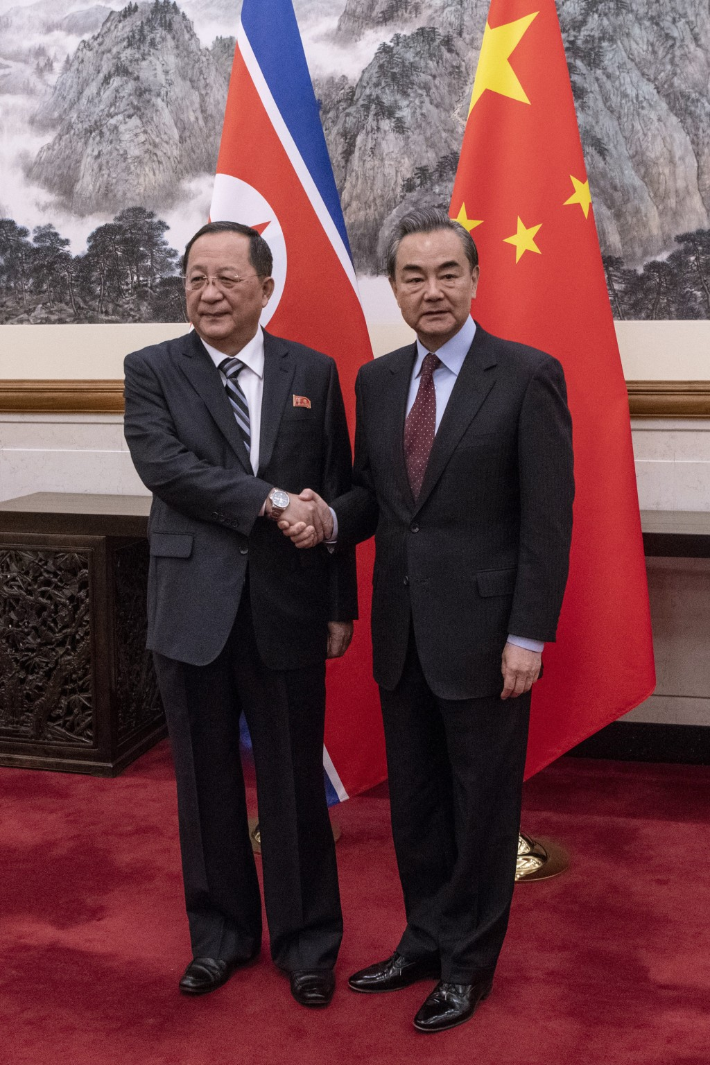 North Korean Foreign Minister Ri Yong Ho, left, meets China's Foreign Minister Wang Yi at the Diaoyutai State Guesthouse in Beijing  Friday, Dec. 7, 2