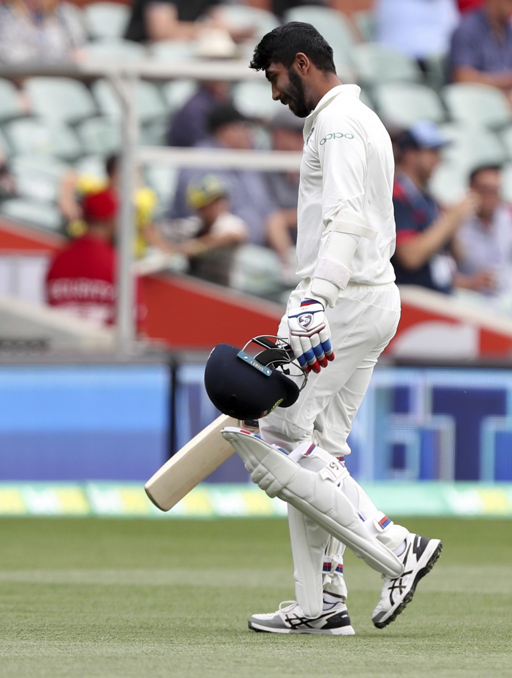 India's Mohammed Shami walks from the field after he was dismissed off the first ball on day two during the first cricket test between Australia and I