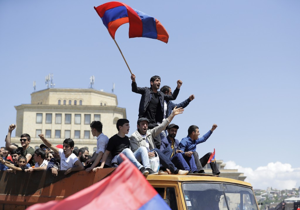 FILE - In this file photo taken on Wednesday, May 2, 2018, Supporters of opposition lawmaker Nikol Pashinian stand atop of a vehicle as they protest i