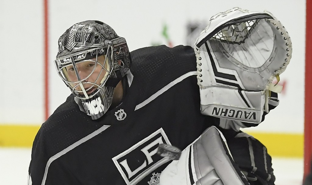 Los Angeles Kings goaltender Jonathan Quick gives up a goal to New Jersey Devils right wing Kyle Palmieri during the first period of an NHL hockey gam