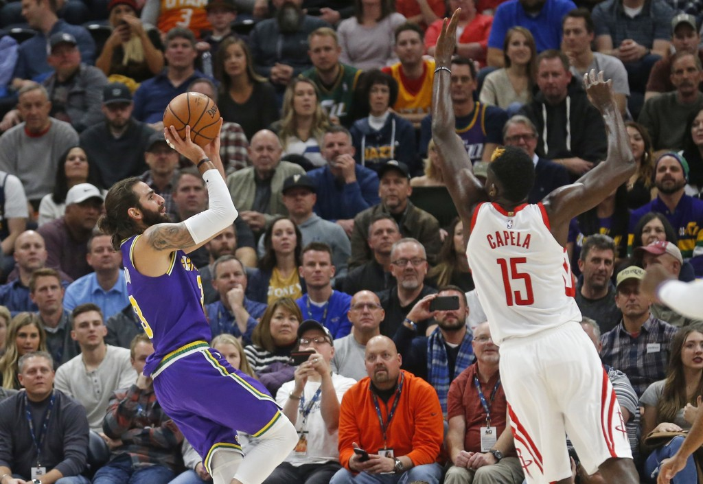 Utah Jazz guard Ricky Rubio (3) shoots as Houston Rockets center Clint Capela (15) defends during the first half during an NBA basketball game Thursda