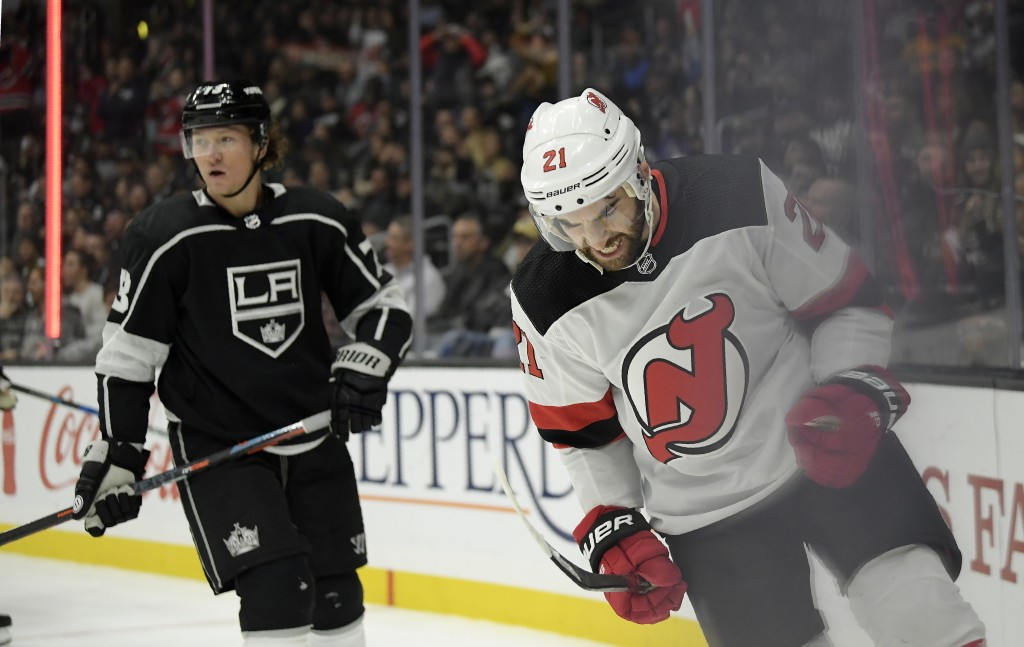 New Jersey Devils right wing Kyle Palmieri, right, celebrates his goal as Los Angeles Kings right wing Tyler Toffoli skates in the background during t
