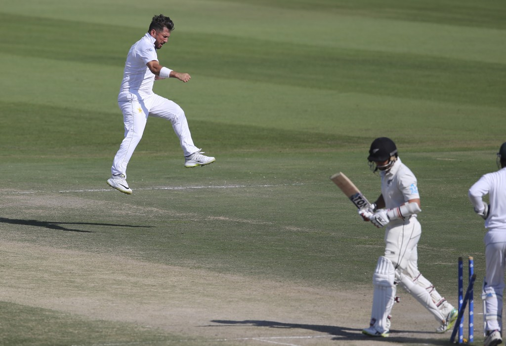 Pakistan's Yasir Shah celebrates dismissal of New Zealand's BJ Watling in their test match in Abu Dhabi, United Arab Emirates, Friday, Dec. 7, 2018. (