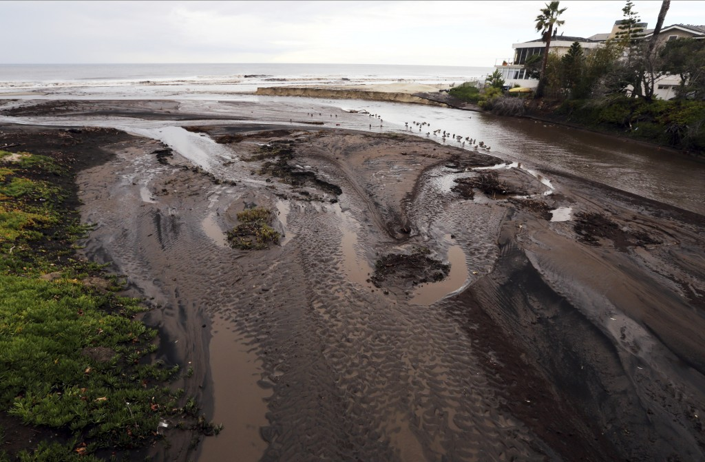 Mud and debris fill the outfall where Trancas Cree...