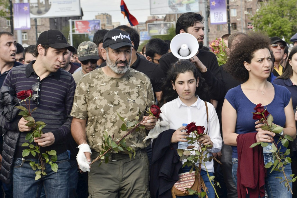 FILE - In this file photo taken on Tuesday, April 24, 2018, Armenian protest leader Nikol Pashinian, second left, leads a march to attend a memorial s