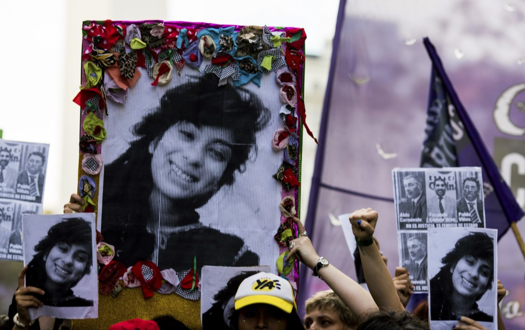 Demonstrators hold posters that show gender violence victim Lucia Perez, 16, during a protest in Buenos Aires, Argentina, on Wednesday, Dec. 5, 2018.